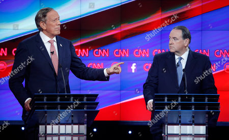 George Pataki, Mike Huckabee George Pataki, left, makes a point as Mike Huckabee looks on during the CNN Republican presidential debate at the Venetian Hotel & Casino, in Las Vegas