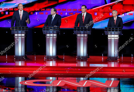 George Pataki, Mike Huckabee, Rick Santorum, Lindsey Graham Republican presidential candidates, from left, George Pataki, Mike Huckabee, Rick Santorum, and Lindsey Graham participate during the CNN Republican presidential debate at the Venetian Hotel & Casino, in Las Vegas
