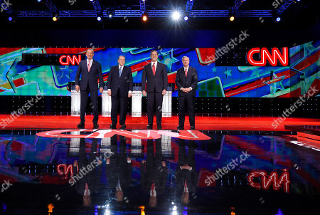 George Pataki, Mike Huckabee, Rick Santorum, Lindsey Graham Republican presidential candidates, from left, George Pataki, Mike Huckabee, Rick Santorum, and Lindsey Graham take the stage during the CNN Republican presidential debate at the Venetian Hotel & Casino, in Las Vegas