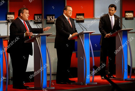 Chris Christie, Mike Huckabee, Bobby Jindal Chris Christie, left, speaks as Mike Huckabee and Bobby Jindal listen during Republican presidential debate at Milwaukee Theatre, in Milwaukee