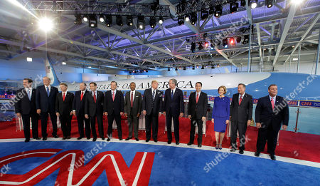 Republican presidential candidates, from left, former Pennsylvania Sen. Rick Santorum, former New York Gov. George Pataki, Sen. Rand Paul, R-Ky., former Arkansas Gov. Mike Huckabee, Sen. Marco Rubio, R-Fla., Sen. Ted Cruz, R-Texas, retired neurosurgeon Ben Carson, businessman Donald Trump, former Florida Gov. Jeb Bush, Wisconsin Gov. Scott Walker, businesswoman Carly Fiorina, Ohio Gov. John Kasich, and New Jersey Gov. Chris Christie take the stage during the CNN Republican presidential debate at the Ronald Reagan Presidential Library and Museum, in Simi Valley, Calif