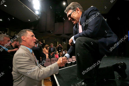 Stock Image of Rick Perry Republican presidential candidate, former Texas Gov. Rick Perry speaks to New Hampshire Union Leader Publisher Joe McQuaid, left, after a forum, in Manchester, N.H