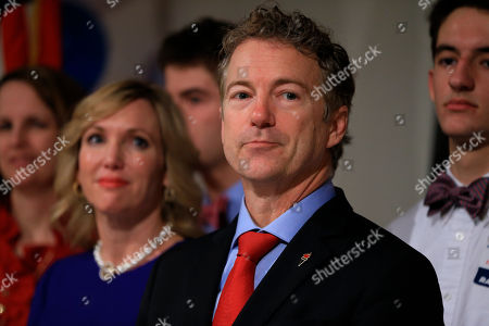 Rand Paul, Kelley Paul Republican presidential candidate, Sen. Rand Paul, R-Ky, stands with his wife Kelley and family members as he waits to speaks to supporters during a caucus night victory party at the Scottish Rite Consistory in Des Moines, Iowa