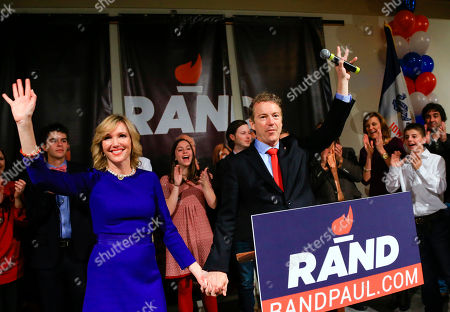 Rand Paul, Kelley Paul Republican presidential candidate, Sen. Rand Paul, R-Ky, and his wife Kelley wave to supporters at a caucus night rally at the Scottish Rite Consistory in Des Moines, Iowa