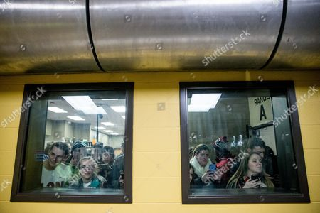 Rand Paul Visitors watch as Republican presidential candidate Sen. Rand Paul, R-Ky., fires an AR-15 rifle at Crossroads Shooting Sports in Johnston, Iowa