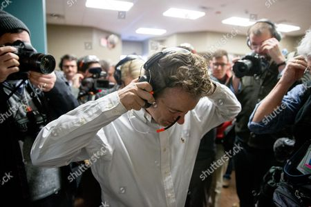 Rand Paul Republican presidential candidate Sen. Rand Paul, R-Ky., puts on protective gear as he gets ready to fire an AR-15 rifle at Crossroads Shooting Sports in Johnston, Iowa