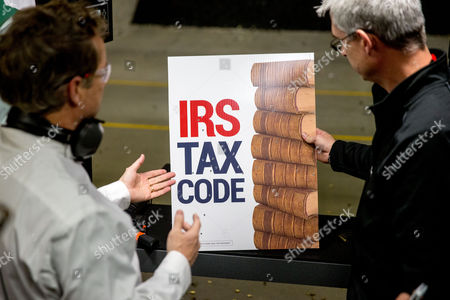 """Rand Paul, Tom Hudson Republican presidential candidate Sen. Rand Paul, R-Ky., left, speaks with General Manager Tom Hudson, right, after firing an AR-15 rifle at an """"IRS Tax Code"""" sign at Crossroads Shooting Sports in Johnston, Iowa"""
