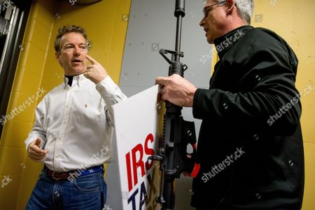 """Stock Photo of Rand Paul, Tom Hudson Republican presidential candidate Sen. Rand Paul, R-Ky., speaks with General Manager Tom Hudson, right, after firing an AR-15 rifle at an """"IRS Tax Code"""" sign at Crossroads Shooting Sports in Johnston, Iowa"""