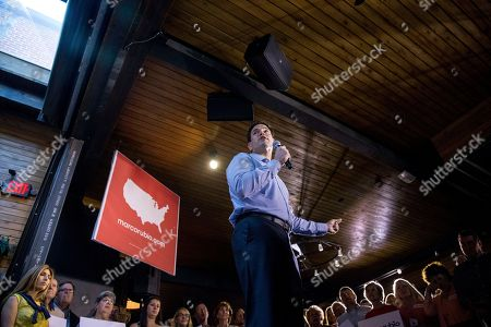 Marco Rubio, Jeanette Dousdebes Republican presidential candidate, Sen. Marco Rubio, R-Fla., speaks during a rally at Town Hall in Cleveland, before Thursday's first Republican presidential debate being held at the Quicken Loans Arena. Also pictured is Rubio's wife Jeanette Dousdebes, far left