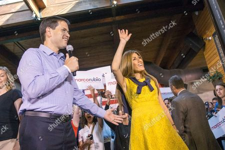 Marco Rubio Republican presidential candidate, Sen. Marco Rubio, R-Fla., introduces his wife Jeanette Dousdebes as he takes the stage during a rally at Town Hall in Cleveland, before Thursday's first Republican presidential debate being held at the Quicken Loans Arena