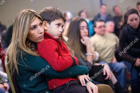 Jeanette Dousdebes, Dominic Rubio Jeanette Dousdebes sits with her son Dominic Rubio, 8, as her husband Republican presidential candidate, Sen. Marco Rubio, R-Fla. speaks at Rastrelli's Tuscany Special Events Center in Clinton, Iowa