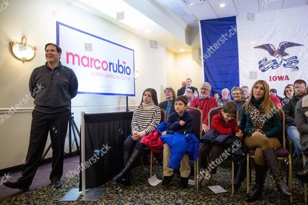 Marco Rubio, Jeanette Dousdebes Republican presidential candidate, Sen. Marco Rubio, R-Fla., left, stands next to his wife Jeanette Dousdebes, right, and their children, from left, Daniella, 13, Anthony, 10, and Dominic, 8, as he waits to speaks at Rastrelli's Tuscany Special Events Center in Clinton, Iowa