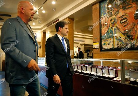 Marco Rubio, Rick Harrison Republican presidential candidate Sen. Marco Rubio, right, R-Fla., tours the World Famous Gold & Silver Pawn shop with owner Rick Harrison, in Las Vegas. Harrison is on the television show Pawn Stars