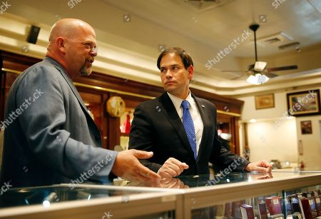 Marco Rubio, Rick Harrison Republican presidential candidate Sen. Marco Rubio, R-Fla., right, tours the World Famous Gold & Silver Pawn shop with owner Rick Harrison, in Las Vegas. The shop is featured in the television show Pawn Stars