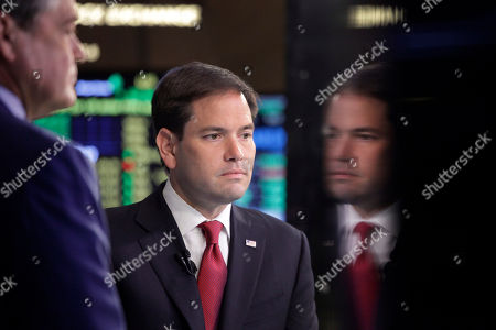 Marco Rubio Republican presidential candidate Sen. Marco Rubio, R-Fla., pauses prior to an interview with CNBC correspondent John Harwood, left, at the New York Stock Exchange