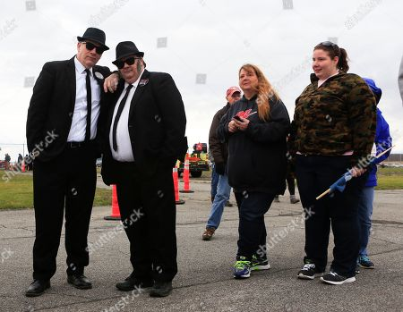 Don Hayes, Nick Ross Don Hayes and Nick Ross of Rome, N.Y., wait in line before a rally for Republican presidential candidate Donald Trump at Griffiss International Airport in Rome, N.Y