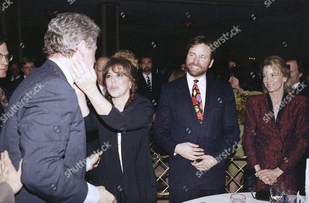 Bill Clinton, Linda Bloodworth-Thomason Democratic Presidential candidate, Gov. Bill Clinton of Arkansas, gets a warm greeting from Arkansas native and television producer Linda Bloodworth-Thomason, as actor producer John Ritter, right, looks on during a fundraiser in Beverly Hills, California