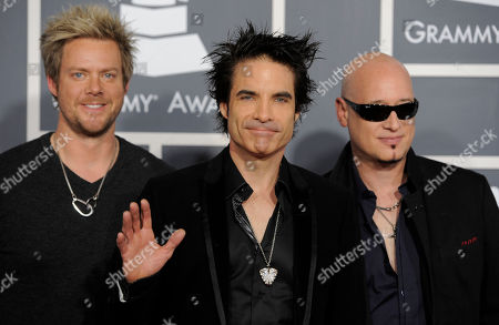 Scott Underwood, Patrick Monahan, Jimmy Stafford From left, Scott Underwood, Patrick Monahan and Jimmy Stafford of music group Train arrive at the 53rd annual Grammy Awards, in Los Angeles