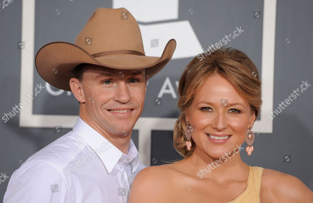Ty Murray,Jewel Jewel, right, and her husband,Ty Murray, arrive at the 53rd annual Grammy Awards, in Los Angeles