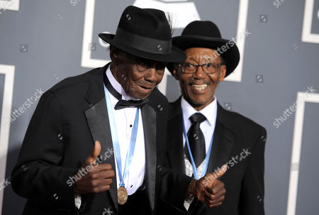 """Stock Image of Pinetop Perkins, Willie Smith Pinetop Perkins, left, and Willie """"Big Eyes"""" Smith arrive at the 53rd annual Grammy Awards, in Los Angeles"""