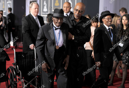 """Stock Photo of Pinetop Perkins, Willie Smith Pinetop Perkins, left, and Willie """"Big Eyes"""" Smith, right, arrive at the 53rd annual Grammy Awards, in Los Angeles. Man in center is unidentified"""