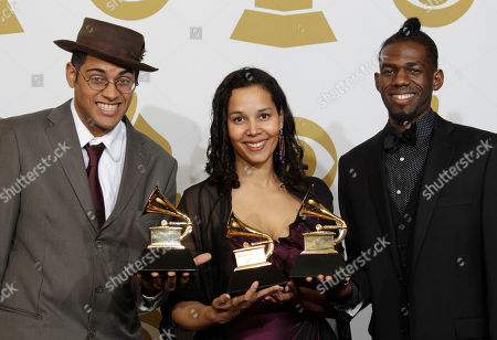 Dom Flemons, Rhiannon Giddens,Justin Robinson Musicians Dom Flemons, left, Rhiannon Giddens and Justin Robinson, of the Carolina Chocolate Drops, pose with the award for best traditional folk album backstage at the 53rd annual Grammy Awards, in Los Angeles