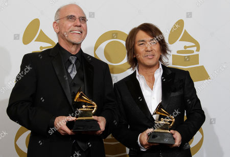 Larry Carlton, Tak Matsumoto Larry Carlton, left, and Takahiro Matsumoto pose backstage with the award for best pop instrumental album at the 53rd annual Grammy Awards, in Los Angeles