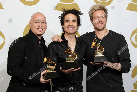 Jimmy Stafford, Patrick Monahan, Scott Underwood From left, Jimmy Stafford, Patrick Monahan and Scott Underwood of Train pose backstage with the award for best performance by a duo or group with vocals at the 53rd annual Grammy Awards, in Los Angeles