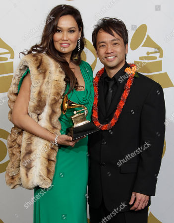 Tia Carrere Tia Carrere, left, and Daniel Ho pose with the award for best Hawaiian music album backstage at the 53rd annual Grammy Awards, in Los Angeles