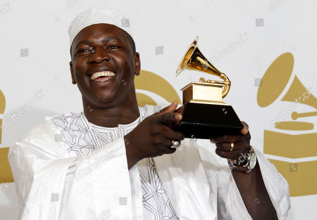 Vieux Farka Toure Vieux Farka Toure is seen backstage with the award for best traditional world music album at the 53rd annual Grammy Awards, in Los Angeles