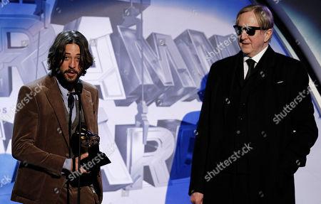 Ryan Bingham, T Bone Burnett Ryan Bingham, left, and T Bone Burnett are seen accepting the award for song mp/tv/ovm during the pre-telecast at the 53rd annual Grammy Awards, in Los Angeles
