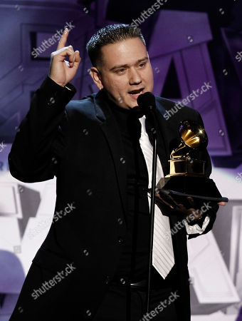 """Jorge Hernandez Jorge """"El Guero"""" Hernandez accepts the award for best banda album during the pre-telecast at the 53rd annual Grammy Awards, in Los Angeles"""