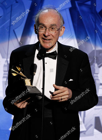 Stock Photo of Keith O. Johnson Keith O. Johnson accepts the award for surround sound album during the pre-telecast at the 53rd annual Grammy Awards, in Los Angeles