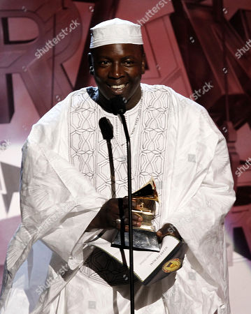 Vieux Farka Toure Vieux Farka Toure accepts the award for best traditional world music album during the pre-telecast at the 53rd annual Grammy Awards, in Los Angeles