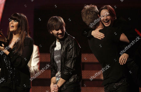 Hillary Scott, Dave Haywood, Charles Kelley, Josh Kear From left, Hillary Scott, Dave Haywood and Charles Kelley of Lady Antebellum are joined onstage by Josh Kear to accept the award for best country album at the 53rd annual Grammy Awards, in Los Angeles