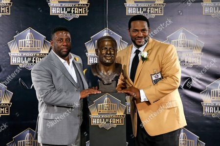 Jerome Bettis, John Bettis III Former NFL player Jerome Bettis, right, poses with his bust and presenter, his brother, John Bettis III, during an induction ceremony at the Pro Football Hall of Fame, in Canton, Ohio
