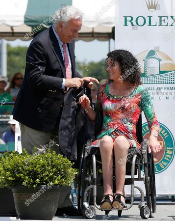 Francesco Ricci Bitti, Chantal Vandierendonck President of the International Tennis Federation Francesco Ricci Bitti presents a blazer to Chantal Vandierendonck, of the Netherlands, during the induction ceremony at the International Tennis Hall of Fame in Newport, R.I