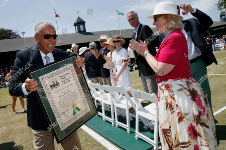 Nick Bollettieri Nick Bollettieri holds his plaque following the induction ceremony at the International Tennis Hall of Fame in Newport, R.I