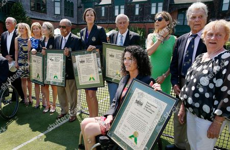 Hall of famers, from left, Owen Davidson, Tracy Austin, Chris Everet, Jane Brown Grimes, Nick Bollettieri, Lindsay Davenport, John Barrett, Monica Seles, Chantal Vandierendonck, seated, Vic Seixas, Peachy Kellmeyer Hall of famers, from left, Owen Davidson, Tracy Austin, Chris Everet, Jane Brown Grimes, Nick Bollettieri, Lindsay Davenport, John Barrett, Monica Seles, Chantal Vandierendonck, seated, Vic Seixas and Peachy Kellmeyer gather for a photograph following enshrinement of the class of 2014 at the International Tennis Hall in Newport, R.I