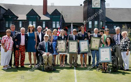 Rosie Casals, Charlie Pasarell, Bud Collins, Pam Shriver, Owen Davidson, Tracy Austin, Chris Evert, Jane Brown Grimes, Nick Bollettieri, Lindsay Davenport, John Barrett, Monica Seles, Vic Seixas, Peachy Kellmeyer, Brad Parks, Chantal Vandierendonck Hall of Famers, back row from left, Rosie Casals, Charlie Pasarell, Bud Collins, Pam Shriver, Owen Davidson, Tracy Austin, Chris Evert, Jane Brown Grimes, Nick Bollettieri, Lindsay Davenport, John Barrett, Monica Seles, Vic Seixas, Peachy Kellmeyer and front row, Brad Parks, left, and Chantal Vandierendonck pose following the induction ceremony at the International Tennis Hall of Fame in Newport, R.I
