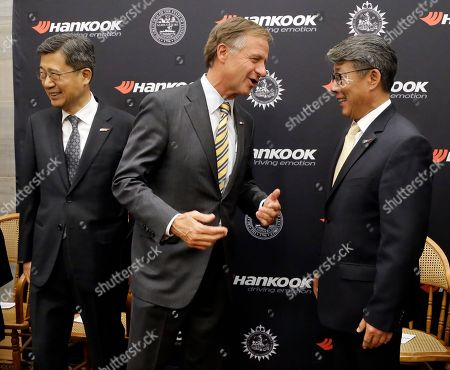 Bill Haslam, S H John Sun, Hee Se Ahn Tennessee Gov. Bill Haslam, center, talks with Hee Se Ahn, president of Hankook Tire America Corp., in Nashville, Tenn., after it was announced that Hankook is relocating its North American headquarters from New Jersey to Tennessee. At left is S. H. John Sun, vice chairman and CEO of Hankook Tire
