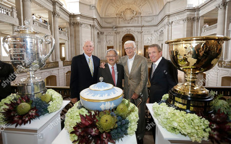 PGA of America President Ted Bishop, from left, poses for photos with San Francisco Mayor Ed Lee, Sandy Tatum, former president of the United States Golf Association, and PGA Tour Commissioner Tim Finchem after a news conference announcing that TPC Harding Park will host the U.S. PGA Championship in 2020 and the Presidents Cup in 2025 at City Hall in San Francisco, . TPC Harding Park will also host the Match Play Championship in 2015