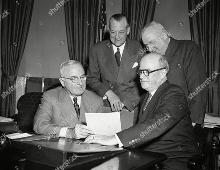 Harry S. Truman Left to right (standing) are: E. A. Roberts, Philadelphia, President of the United Defense Fund, Inc.; Ralph H. Blanchard, New York City, Executive Director of the United Defense Fund and Community Chests and Councils of America, Inc. From left to right (seated) are: President Truman, and Secretary of the Navy Francis Matthews, at White House in Washington on . Roberts informed Truman that the mobilization of community resources to finance emergency health and welfare services made necessary by the nation's stepped up defense effort is underway