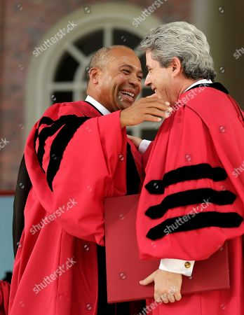 Deval Patrick, Marc Goodheart Former Massachusetts Gov. Deval Patrick, left, is presented with an honorary Degree of Laws by Vice President and Secretary of Harvard University Marc Goodheart, right, during Harvard commencement exercises, in Cambridge, Mass. Patrick also gave the commencement address