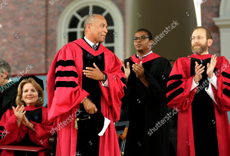 Renee Fleming, Deval Patrick, Alan Garber Former Massachusetts Gov. Deval Patrick, center left, receives applauded by soprano Renee Fleming, left, and University Provost Alan Garber, right, during Harvard University commencement exercises, in Cambridge, Mass. Patrick was presented with an honorary Doctor of Laws degree during the ceremony and made the commencement address