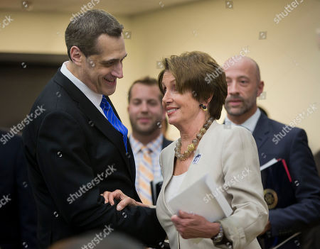 Nancy Pelosi, Stuart Milk Stuart Milk, right, Founder and President, Harvey Milk Foundation and nephew of Harvey Milk, greets during the unveiling ceremony of the Harvey Milk Forever Stamp in the South Court Auditorium in the Eisenhower Executive Office Building on the White House complex, in Washington. On the day he would have turned 84 years old, Harvey Milk, the San Francisco supervisor and gay activist gunned down at City Hall in 1978, had a postal stamp in his honor unveiled at the White House today