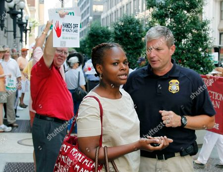 Stock Image of Crystal Johnson Crystal Johnson, a supporter of President Barack Obama's health care overhaul, is escorted away from an anti-healthcare protest outside the 11th Circuit Court of Appeals in Atlanta, . A three-judge panel of the 11th Circuit Court of Appeals is hearing arguments on whether to reverse a Florida judge's ruling that struck down the law