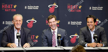 Goran Dragic, Pat Riley, Erik Spoelstra Miami Heat president Pat Riley, left, Goran Dragic, center, and head coach Erik Spoelstra, right, have a light moment during a news conference, in Miami