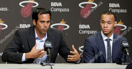 Erik Spoelstra, Shabazz Napier Miami Heat head coach Erik Spoelstra, left, gestures during a news conference as Shabazz Napier listens in Miami, . The Heat acquired the draft rights to Connecticut guard Shabazz Napier in a trade with the Charlotte Hornets on Thursday night, giving up the 26th and 55th picks to make the deal happen, along with a future second-round choice and cash considerations