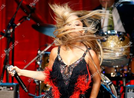 Stock Photo of Kat de Luna Kat de Luna flips her hair as she performs during the Hispanic Heritage Awards, at the Warner Theater, in Washington